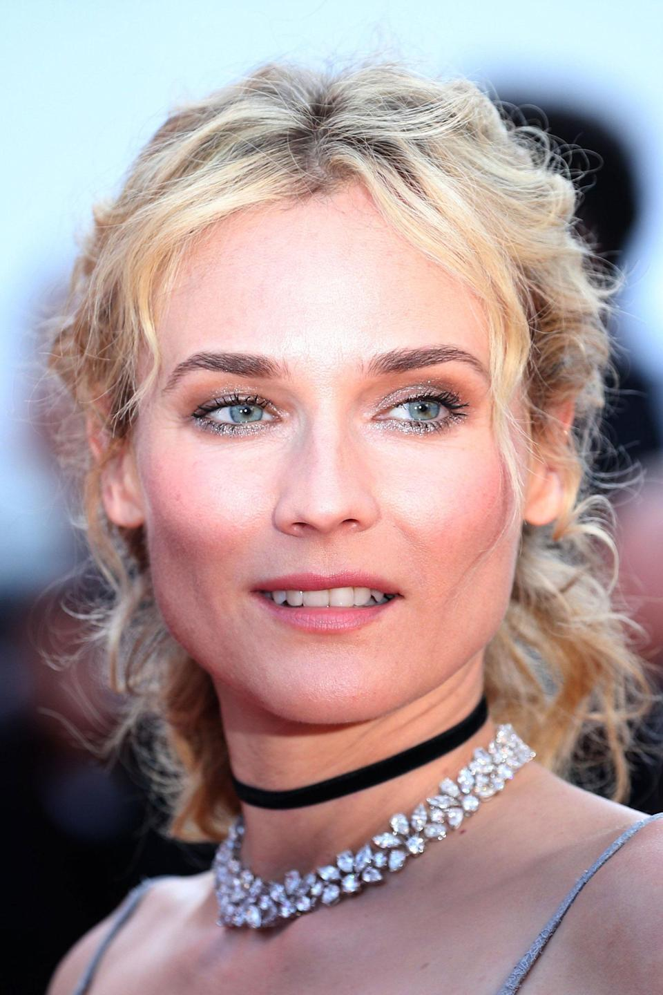 <p>Kruger matched her make-up to her jewels, with dazzling metallic eye shadow. Her hair was styled in full bodied waves, crafted together in a half-up style at the back.</p>