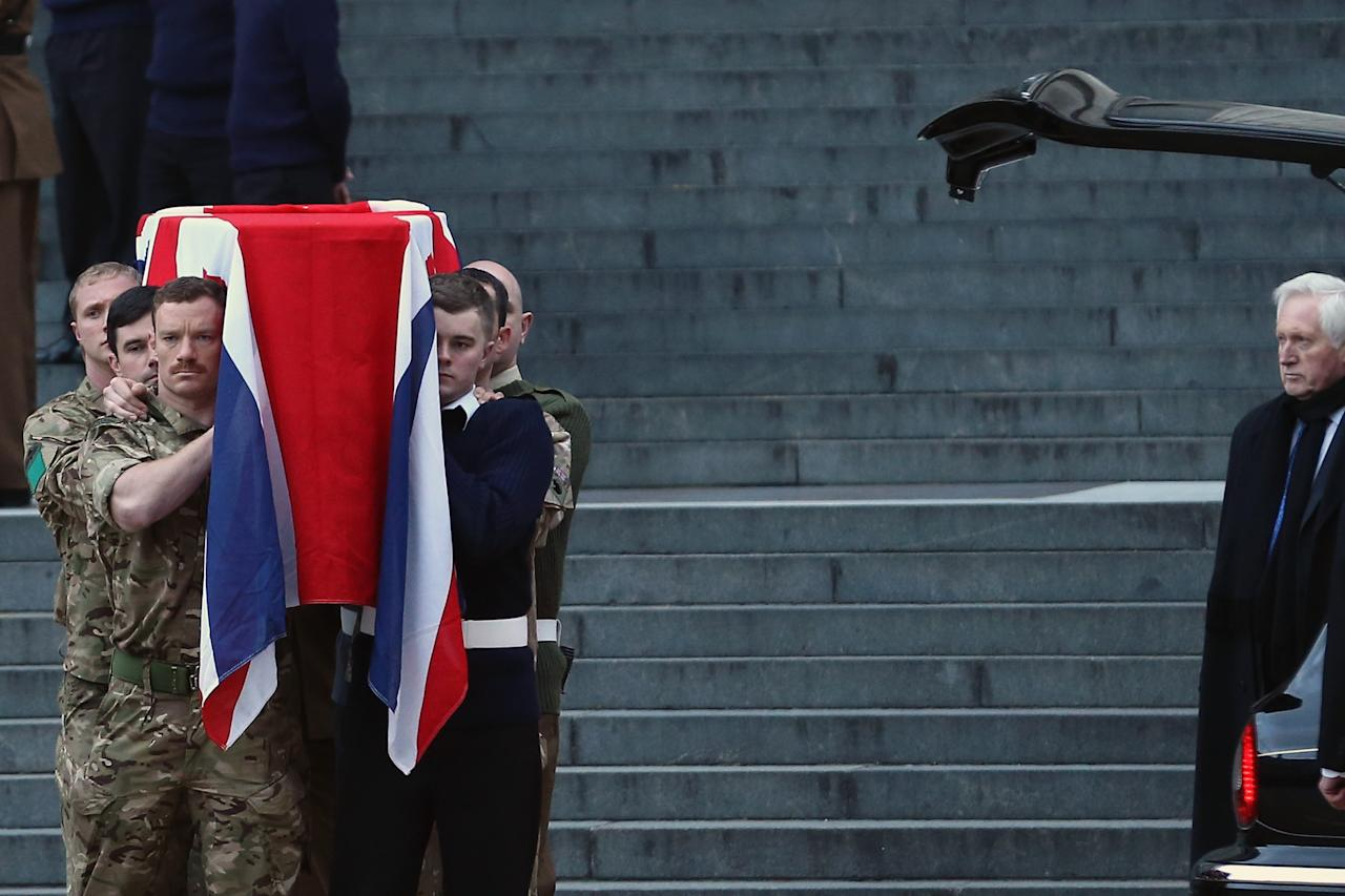 LONDON, ENGLAND - APRIL 15:  A flag draped coffin is carried out during a full military rehearsal for the ceremonial funeral procession for former British Prime Minister Margaret Thatcher outside from St Paul's Cathedral in the early morning on April 15, 2013 in London, England. On Wednesday April 17, over 2,000 guests including global political figures and celebrities will attend the funeral of Margaret Thatcher at St Paul's Cathedral. The service will include 700 serving Armed Forces personnel, and will be led by the Band of the Royal Marines. The 87 year-old former prime minister died after suffering a stroke on April 8.  (Photo by Dan Kitwood/Getty Images)
