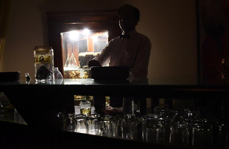 A bartender prepares drinks at a club in Karachi (AFP Photo/Asif Hassan)
