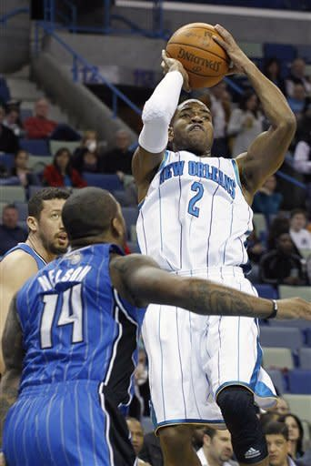 New Orleans Hornets point guard Jarrett Jack (2) shoots over Orlando Magic point guard Jameer Nelson (14) in the first half of an NBA basketball game in New Orleans, Friday, Jan. 27, 2012. (AP Photo/Bill Haber)