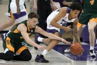 North Dakota State guard Boden Skunberg, left, and TCU guard Taryn Todd, right, compete for a loose ball in the second half of an NCAA college basketball game in Fort Worth, Texas, Tuesday, Dec. 22, 2020. (AP Photo/Tony Gutierrez)