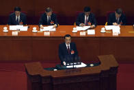 Chinese Premier Li Keqiang delivers a speech during the opening session of China's National People's Congress (NPC) at the Great Hall of the People in Beijing, Friday, March 5, 2021. (AP Photo/Andy Wong)
