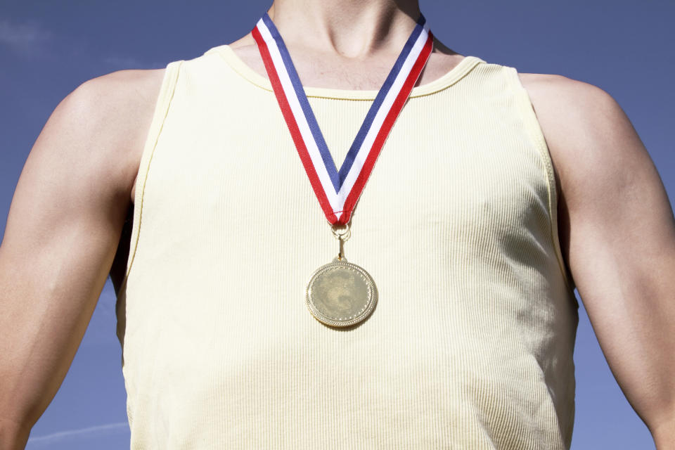 Close up of winning 2012 . Athlete wearing their gold 1st place medal around their neck.