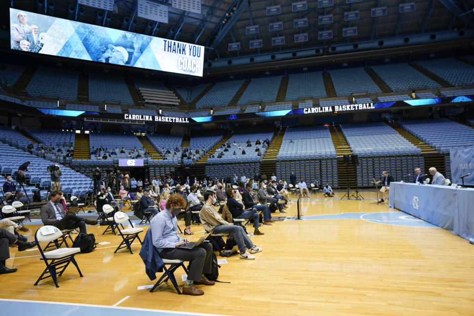 North Carolina Head Basketball Coach Roy Williams, right, speaks with members of the media during a news conference, Thursday, April 1, 2021, in Chapel Hill, N.C. Williams is retiring after 33 seasons and 903 wins as a college basketball head coach. The Hall of Fame coach led the University of North Carolina to three NCAA championships in 18 seasons as head coach of the Tar Heels. (AP Photo/Gerry Broome)