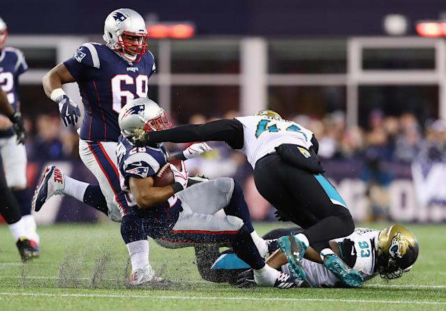 <p>James White #28 of the New England Patriots is tackled by Myles Jack #44 of the Jacksonville Jaguars in the second half during the AFC Championship Game at Gillette Stadium on January 21, 2018 in Foxborough, Massachusetts. (Photo by Adam Glanzman/Getty Images) </p>