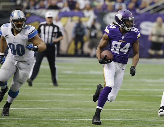 Minnesota Vikings wide receiver Cordarrelle Patterson runs from Detroit Lions defensive tackle Ndamukong Suh, left, during a 50-yard touchdown run in the first half of an NFL football game, Sunday, Dec. 29, 2013, in Minneapolis. (AP Photo/Ann Heisenfelt)