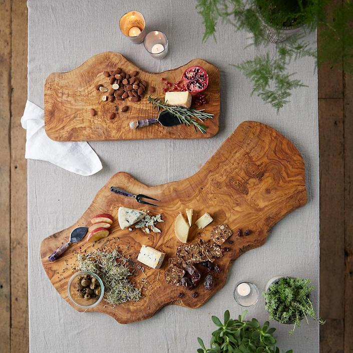 """<h3><strong>Terrain</strong></h3> <br><br><strong>Best For: Rustic-Chic Entertaining Essentials<br></strong>A subset of Anthropologie, Terrain is heaven for garden and outdoor enthusiasts. This is where you not only get your hands on watering cans, outdoor furniture, and planting supplies, but also rustic-chic dining essentials, too.<br><br><strong><em><a href=""""http://www.shopterrain.com/"""" rel=""""nofollow noopener"""" target=""""_blank"""" data-ylk=""""slk:Shop Terrain"""" class=""""link rapid-noclick-resp"""">Shop Terrain</a></em></strong><br><br><strong>Terrain</strong> Olivewood Serving Board, $, available at <a href=""""https://go.skimresources.com/?id=30283X879131&url=https%3A%2F%2Fwww.shopterrain.com%2Fproducts%2Folivewood-serving-board"""" rel=""""nofollow noopener"""" target=""""_blank"""" data-ylk=""""slk:Shop Terrain"""" class=""""link rapid-noclick-resp"""">Shop Terrain</a><br><br><br><br>"""