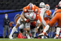 FILE - In this Jan. 1, 2021, file photo, Ohio State quarterback Justin Fields is sacked by Clemson defensive lineman Bryan Bresee during the second half of the Sugar Bowl NCAA college football game in New Orleans. Bresee was selected to The Associated Press Preseason All-America first team defense, Monday Aug. 23, 2021. (AP Photo/Gerald Herbert, File)