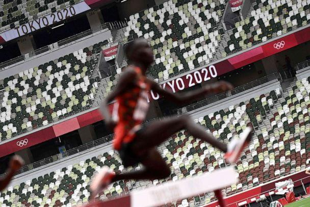 PHOTO: A picture shows empty seats in the stands as athletes compete in the men's 3000m steeplechase heats during the Tokyo 2020 Olympic Games at the Olympic Stadium in Tokyo on July 30, 2021. (Jewel Samad/AFP via Getty Images)