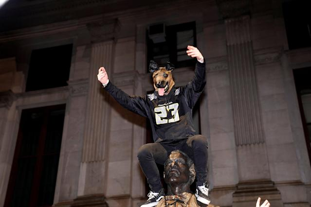 <p>Philadelphia Eagles football fans celebrate their Super Bowl LII victory over the New England Patriots in downtown Philadelphia, Pennsylvania, U.S. February 4, 2018. REUTERS/Jessica Kourkounis </p>