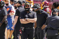 Washington Football Team head coach Ron Rivera, walking on the sidelines during the first half of an NFL football game against the Philadelphia Eagles, Sunday, Sept. 13, 2020, in Landover, Md. (AP Photo/Alex Brandon)