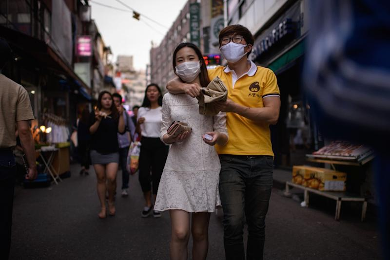 The MERS virus outbreak has triggered widespread public concern in South Korea, with 2,300 people placed under quarantine orders and nearly 1,900 schools closed down (AFP Photo/Ed Jones)