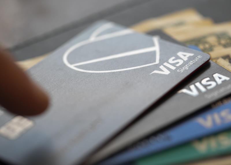 This Aug. 11, 2019, photo shows Visa logos on credit cards in New Orleans. On Monday, Sept. 9, the Federal Reserve releases its July report on consumer borrowing. (AP Photo/Jenny Kane)