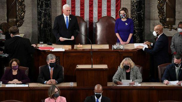 PHOTO: Vice President Mike Pence and Speaker of the House Nancy Pelosi take part in a joint session of Congress to certify the 2020 election results at the U.S. Capitol in Washington, D.C., Jan. 6, 2021. (Saul Loeb/Pool via Reuters)