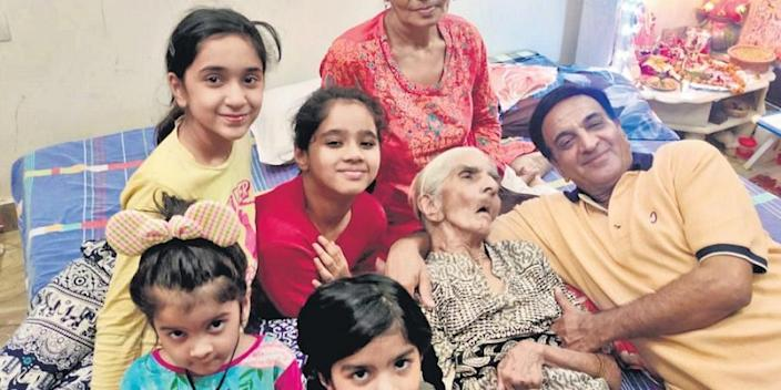 The 96-year-old Pushpa Sharma poses with family at her Shahdara residence in New Delhi | Image credit: PTI
