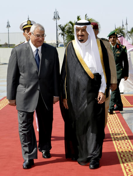 In this photo released by the Saudi Press Agency, Defense Minister and Saudi Crown Prince Salman bin Abdul-Aziz, right, welcomes Egyptian interim President Adly Mansour on his arrival to the airport in Jiddah, Saudi Arabia, Monday, Oct. 7, 2013. Egypt's interim president has landed in Saudi Arabia for his first foreign trip since assuming power after the ouster of the country's Islamist president. (AP Photo)
