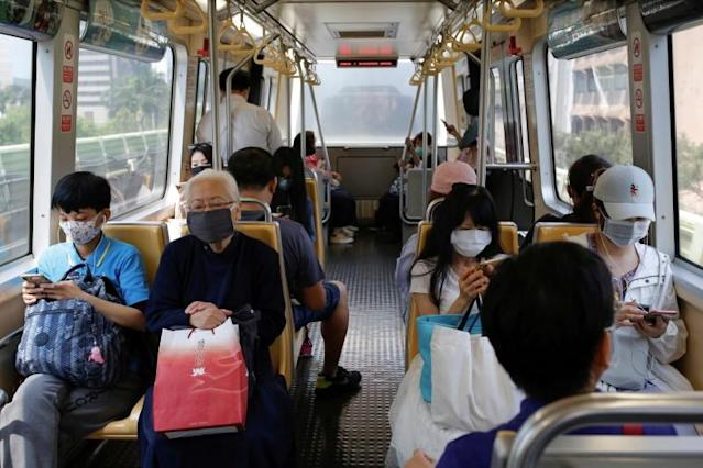 People wear protective face masks inside the metro to protect themselves from the coronavirus disease (COVID-19), in Taipei