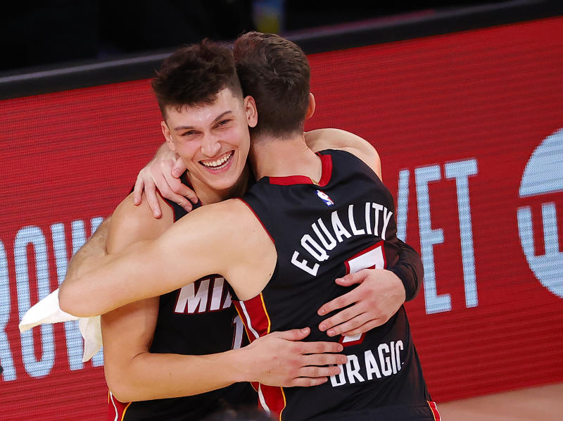 Tyler Herro #14 of the Miami Heat and Goran Dragic #7 of the Miami Heat react after their win over the Boston Celtics in Game Four of the Eastern Conference Finals