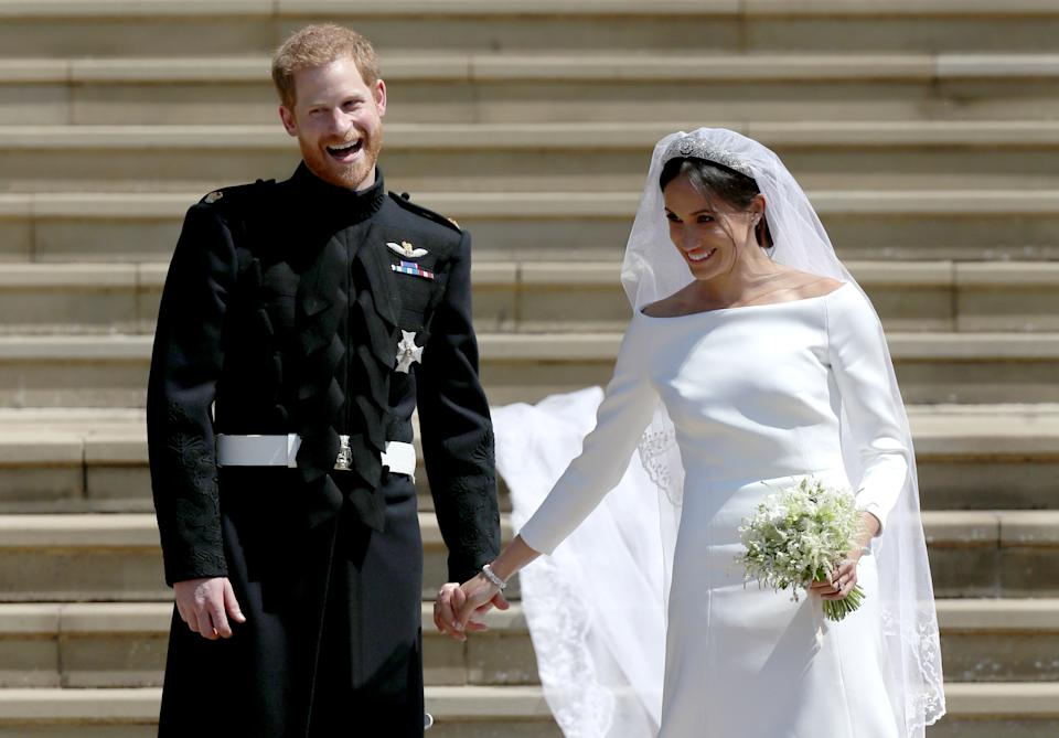 WINDSOR, UNITED KINGDOM - MAY 19:  Prince Harry, Duke of Sussex and the Duchess of Sussex depart after their wedding ceremonyat St George's Chapel at Windsor Castle on May 19, 2018 in Windsor, England. (Photo by Jane Barlow - WPA Pool/Getty Images)