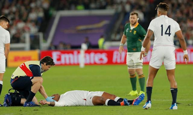 "<span class=""element-image__caption"">England's Kyle Sinckler is treated on the pitch before having to go off following a third-minute collision.</span> <span class=""element-image__credit"">Photograph: Tom Jenkins/The Observer</span>"