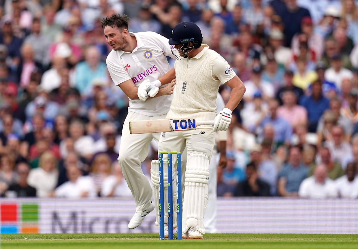 Pitch invader Jarvo 69 runs across the pitch and collides with England's Jonny Bairstow as he bats during day two of the cinch Fourth Test at the Kia Oval, London.