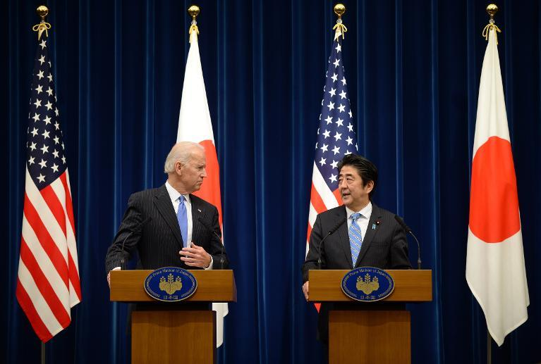 US Vice President Joe Biden (L) holds a joint press conference with Japanese Prime Minister Shinzo Abe (R) after their meeting at Abe's official residence in Tokyo on December 3, 2013