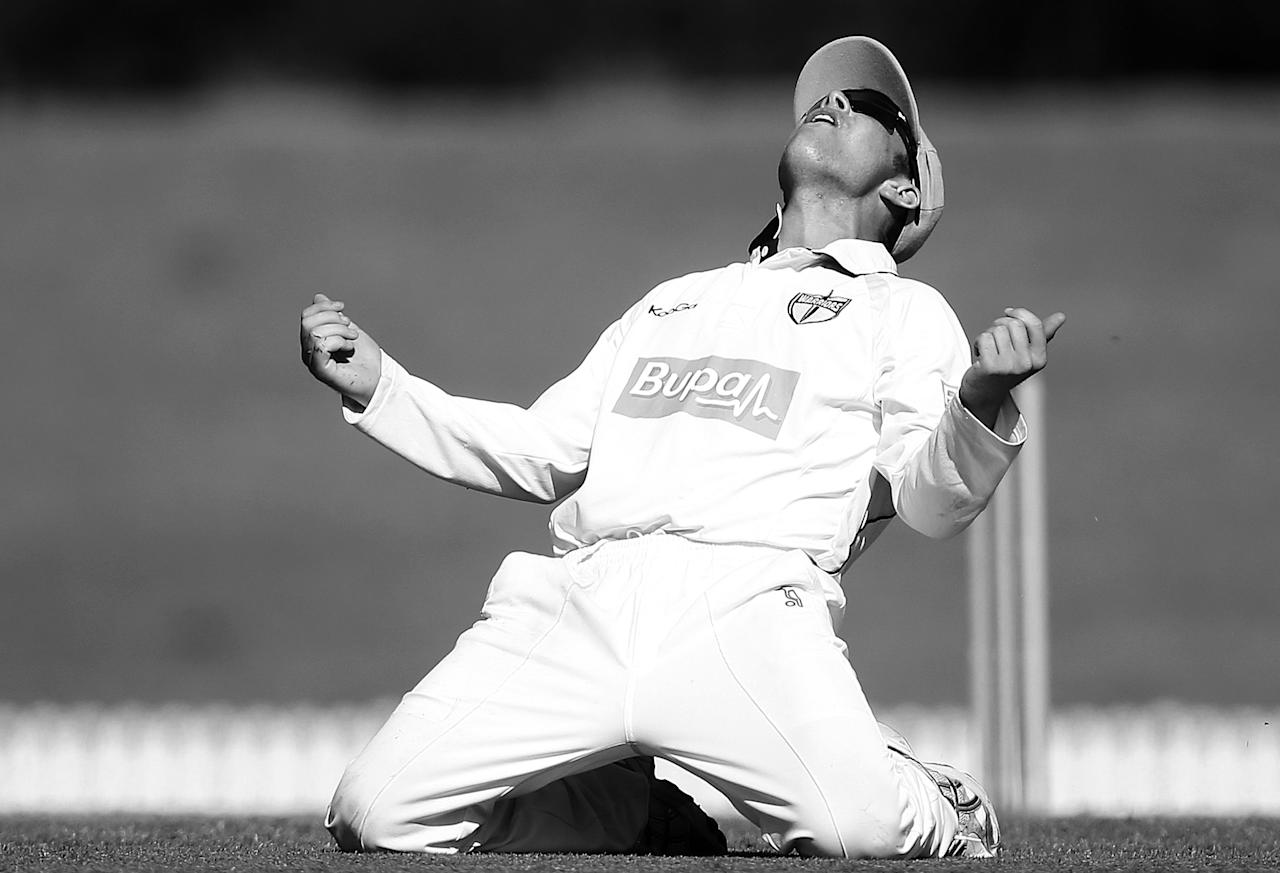 SYDNEY, AUSTRALIA - JANUARY 25:   (EDITORS NOTE: Image has been converted to black and white.) Marcus Harris of the Warriors celebrates catching Steve Smith of the Blues off the bowling of Jason Behrendorff during day two of the Sheffield Shield match between the New South Wales Blues and the Western Australia Warriors at Blacktown International Sportspark on January 25, 2013 in Sydney, Australia.  (Photo by Mark Metcalfe/Getty Images)