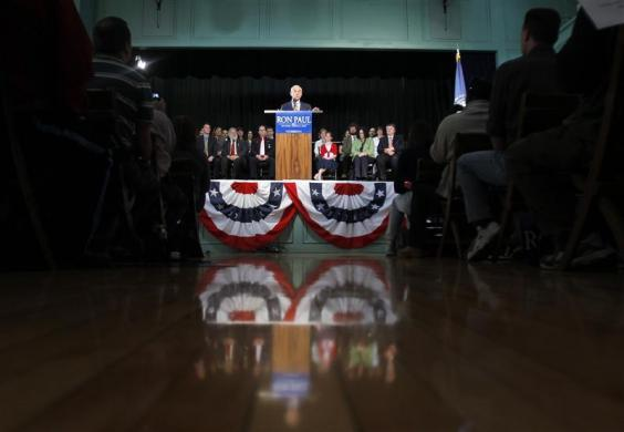 Ron Paul takes the stage for a campaign stop in Exeter, New Hampshire, after announcing his candidacy for the Republican Presidential nomination earlier in the day, May 13, 2011. (REUTERS/Brian Snyder)