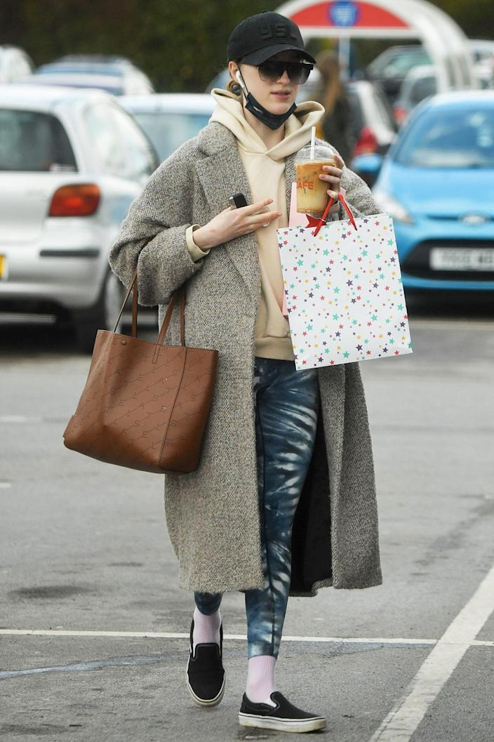 <p><em>Bridgerton</em> star Phoebe Dynevor takes a break from filming to pick up some food at a local supermarket on Saturday in the U.K.</p>