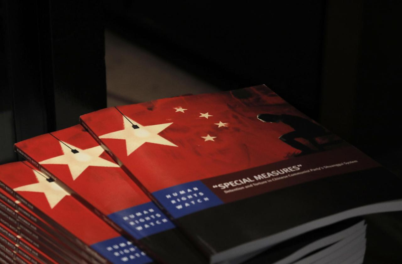 Copies of the new report by Human Rights Watch are seen at The Foreign Correspondents' Club in Hong Kong, Tuesday, Dec. 6, 2016. Torture, solitary confinement and coerced confessions are rife in anticorruption investigations of Chinese Communist Party officials, according to a new report by Human Rights Watch analyzing one of the most secretive aspects of China's one-party system: the supervision of its own party members. (AP Photo/Vincent Yu)