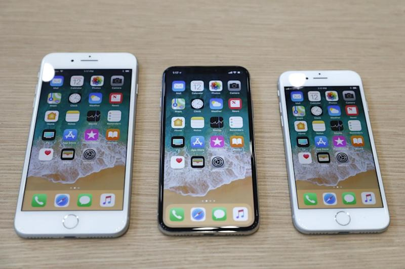 The iPhone 8 Plus, iPhone X and iPhone 8 models (L-R) (REUTERS)