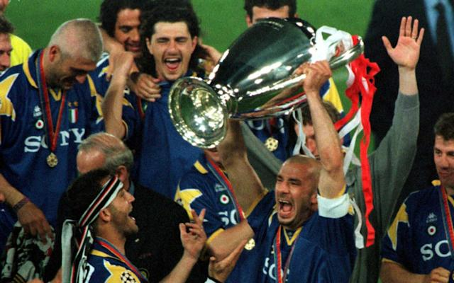 <span>Juventus captain Gianluca Vialli holds aloft the Champions League trophy in 1996</span>