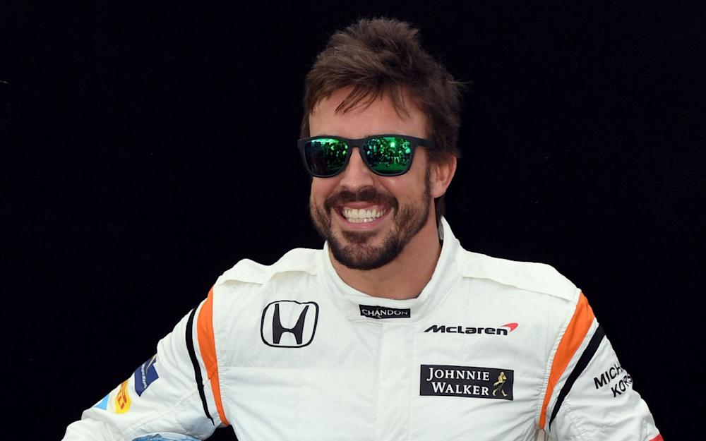 McLaren's Spanish driver Fernando Alonso poses for a photo in Melbourne on March 23, 2017, ahead of the Formula One Australian Grand Prix - Credit: WILLIAM WEST/AFP
