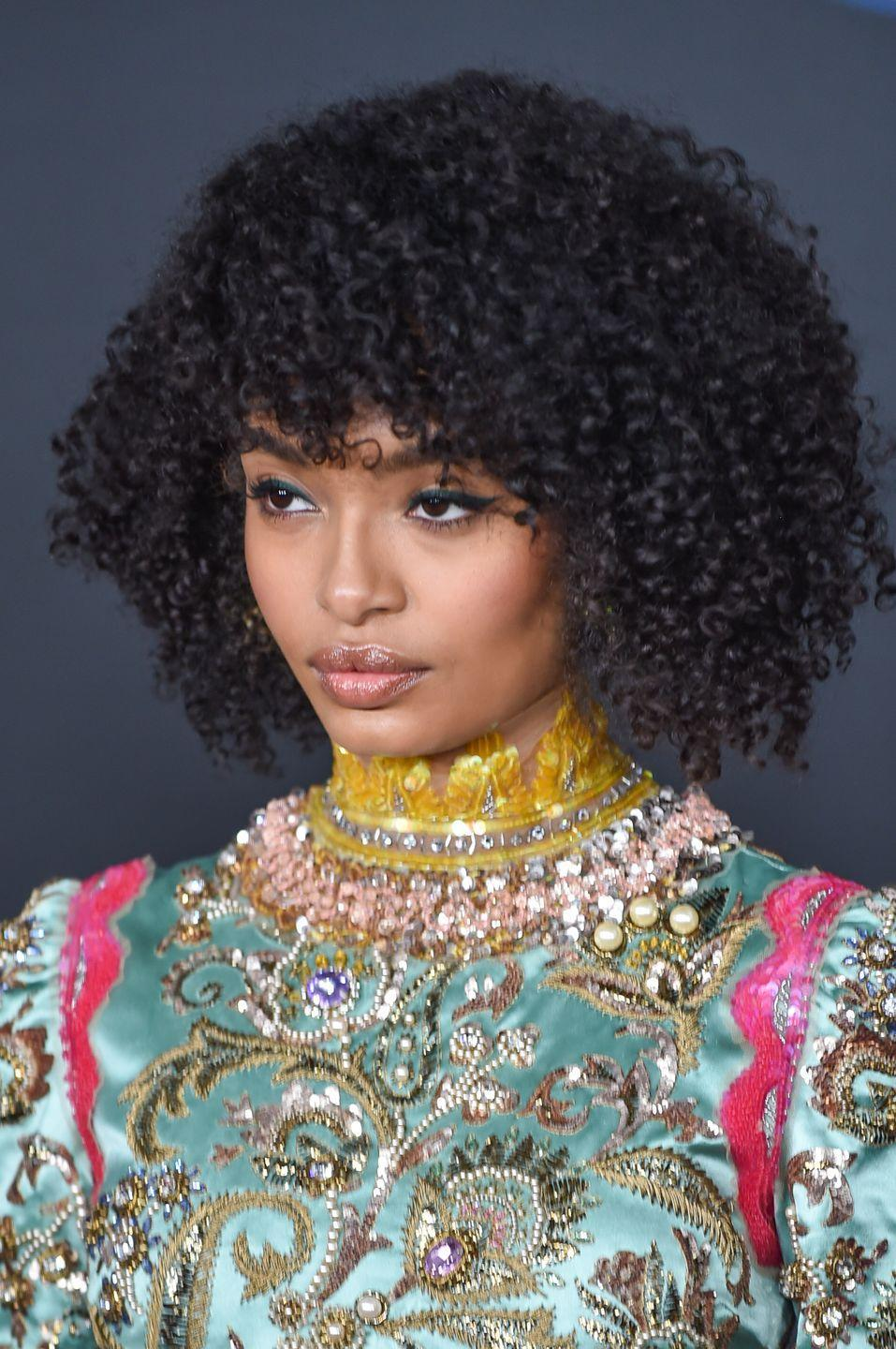 <p>Think that more textured hair doesn't work well with bangs? Think again. These are typically cut longer so that hair won't shrink up your forehead as it curls.</p>