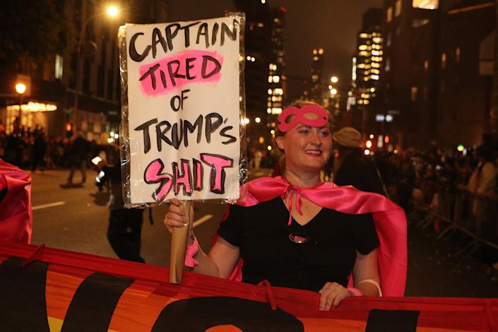 "A reveler from ""Gays Against Guns: carries an anti-Trump sign while marching in the 46th annual Village Halloween Parade in New York City. (Gordon Donovan/Yahoo News)"