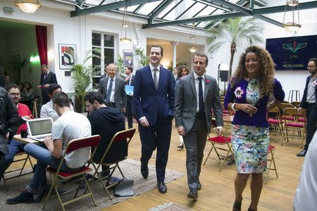 "Britain's Chancellor of the Exchequer George Osborne (L) and French Economy Minister Emmanuel Macron (C) visit the so-called ""incubator"" of French high-tech start-ups ""TheFamily"" with Alice Zagury (R), co-founder and CEO of TheFamily Accelerator,  in Paris, France, July 27, 2015.   REUTERS/Charles Platiau"