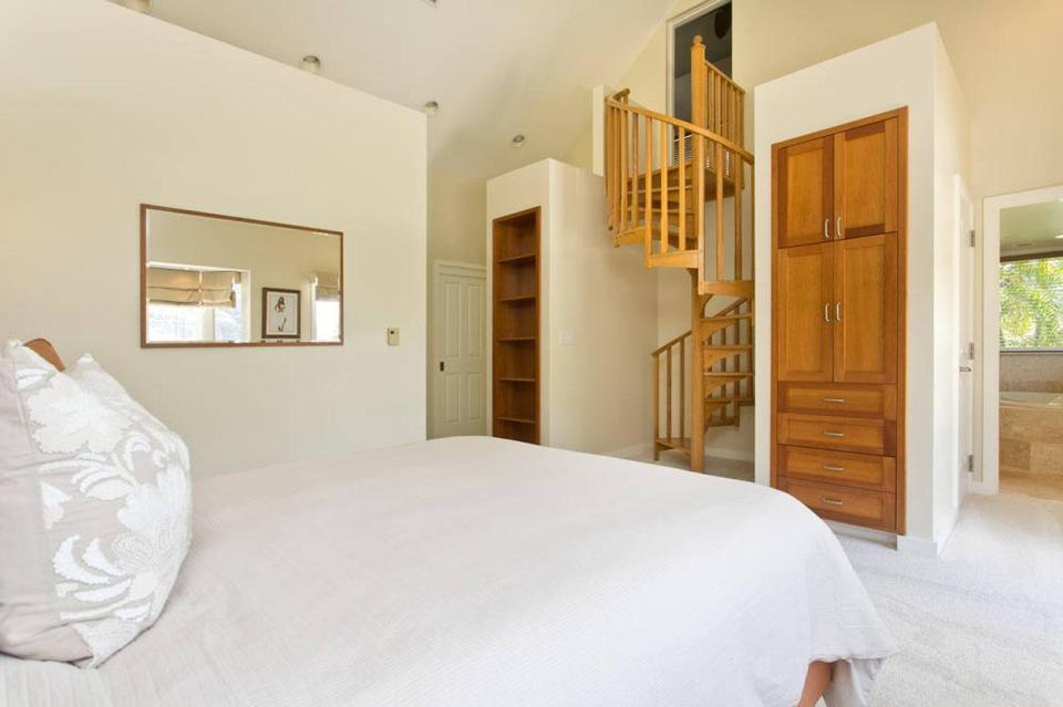 <p>The four-bedroom and four-and-a-half bathroom home has breathtaking views of the surrounding mountains and ocean. The master has a spiral staircase which leads up into a separate private space and its own ensuite bathroom.</p>