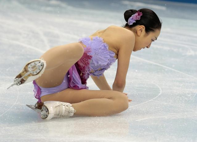 Mao Asada of Japan falls as she competes in the women's team short program figure skating competition at the Iceberg Skating Palace during the 2014 Winter Olympics, Saturday, Feb. 8, 2014, in Sochi, Russia. (AP Photo/Ivan Sekretarev)