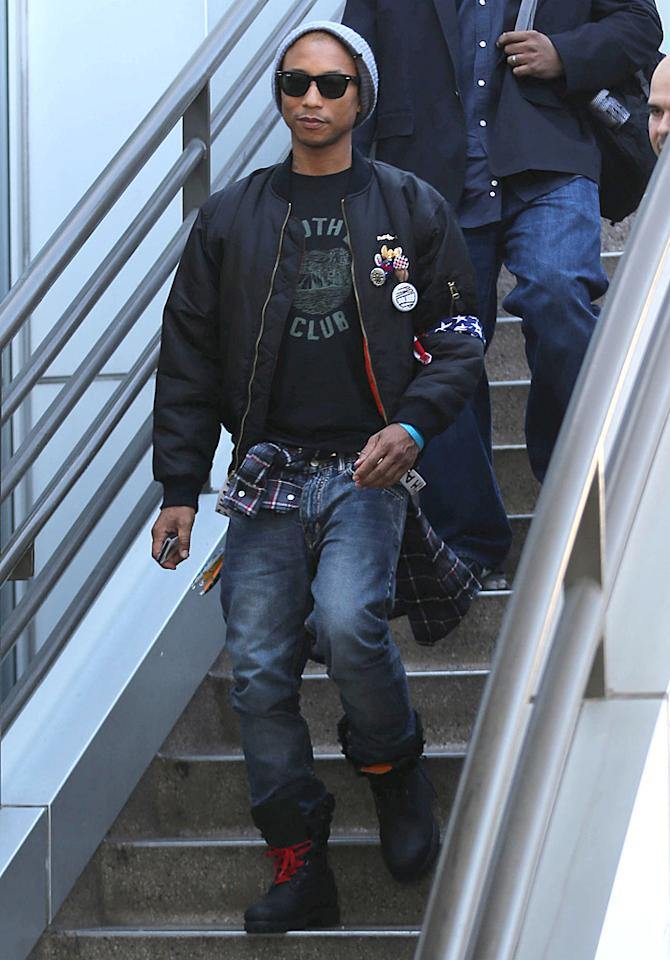 50967187 Rapper and producer Pharrell Williams arriving on a flight at LAX airport in Los Angeles, California on December 10, 2012. Pharrell just listed his Penthouse in Miami for 16.8 million dollars FameFlynet, Inc - Beverly Hills, CA, USA -  1 (818) 307-4813