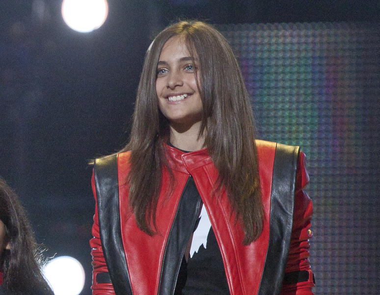 FILE - In this Oct. 8, 2011 file photo Paris Jackson smiles on stage at the Michael Forever the Tribute Concert, at the Millennium Stadium in Cardiff, Wales. Jackson is physically fine after being taken to a hospital early Wednesday, June 5, 2013, an attorney for Jackson's mother said. Perry Sanders Jr. writes in a statement that Paris Jackson is getting appropriate medical attention and the family is seeking privacy. Fire and sheriff's officials confirmed they transported someone from a home in Paris' suburban Calabasas neighborhood for a possible overdose but did not release any identifying information or additional details. (AP Photo/Joel Ryan, File)