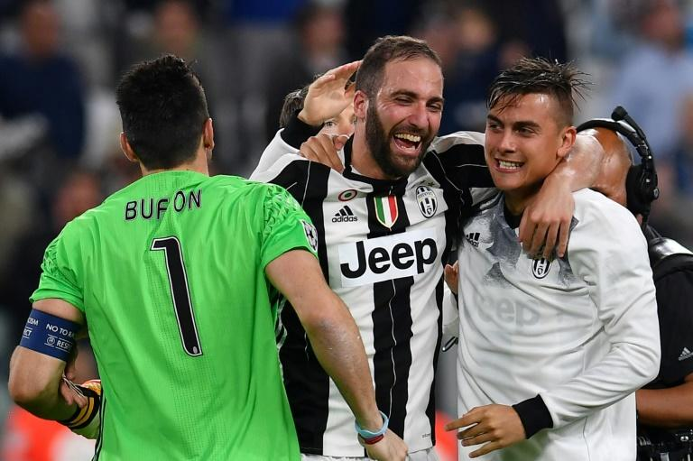 (From L)Juventus' goalkeeper Gianluigi Buffon, Gonzalo Higuain and Paulo Dybala celebrate at the end of their UEFA Champions League semi-final 2nd leg match against Monaco, in Turin, on May 9, 2017
