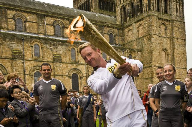 Cricketer Paul Collingwood carries the Olympic Flame on the Torch Relay leg between Durham and Sherburn Hill.