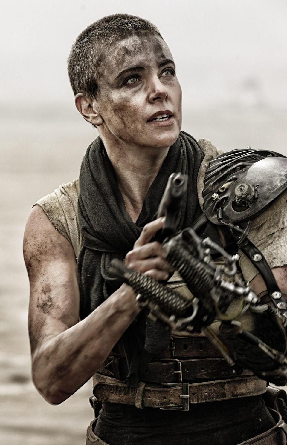 <p>Although her latest role in <em>Atomic Blonde</em> relies on her light locks, Theron had previously buzzed her hair for <em>Mad Max: Fury Road. </em>(Photo: Everett Collection) </p>