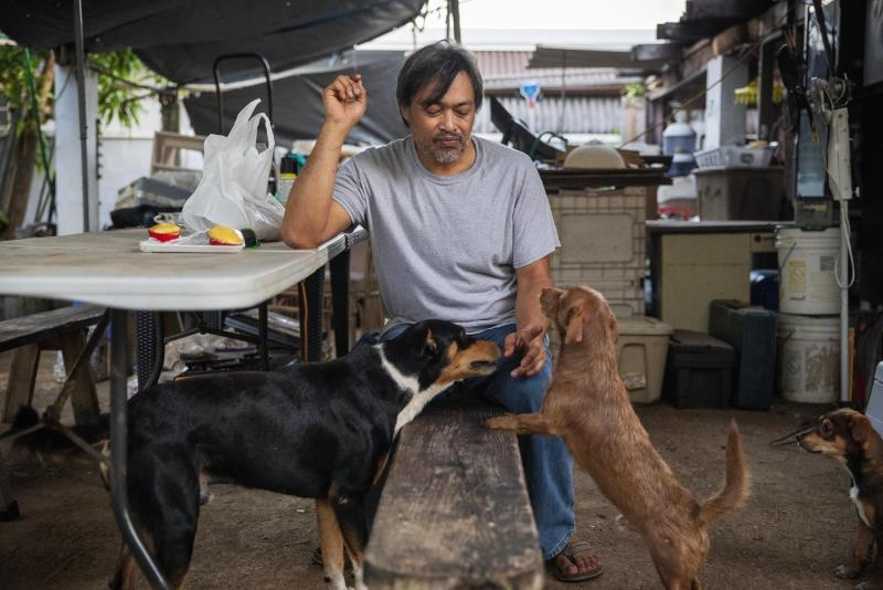 """Mark Apuron, who says he was raped by his uncle, Archbishop Anthony Apuron when he was 15, sits in the backyard of the home he's now staying at in Dededo, Guam, Monday May 13, 2019. He never found the right words to tell his parents what happened. """"I didn't think I would be believed,"""" he said, tearing up. """"I thought I was the only one."""" Over time, Mark Apuron and his parents drifted apart _ a rift he says began the day his father's brother raped him. Anthony Apuron denies the allegations, which are detailed in a lawsuit. (AP Photo/David Goldman)"""