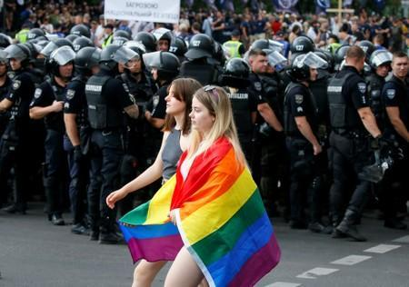 FILE PHOTO: Police officers guard participants of the Equality March, organized by the LGBT community, in Kiev