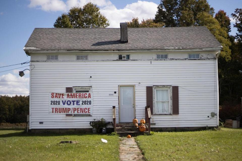 A sign supporting Donald Trump and Mike Pence hangs on a house in Lordstown, Ohio.