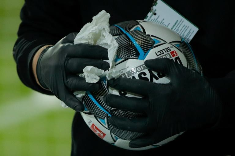 Wiped clean: Match balls are disinfected at the Bundesliga game between Union Berlin and Mainz on Wednesday