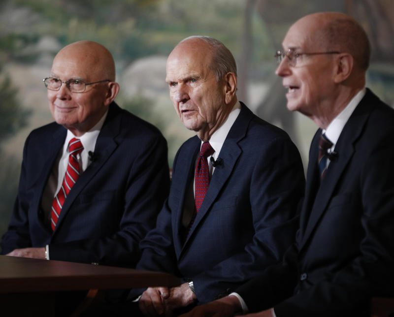 Russell M. Nelson (center), First Counselor Dallin H. Oaks (left), and Second Counselor Henry B. Eyring (right) answer press questions after Nelson was announced as the 17th president of the Mormon Church. (George Frey via Getty Images)