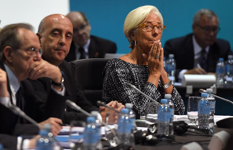 Head of the IMF Christine Lagarde (R) listens to the opening remarks at the G20 Finance Ministers and Central Bank Governors Meeting in Cairns on September 20, 2014 (AFP Photo/William West)