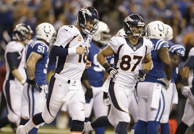 Denver Broncos wide receiver Eric Decker (87) and quarterback Peyton Manning (18) celebrate after a touchdown during the first half of an NFL football game against the Indianapolis Colts, Sunday, Oct. 20, 2013, in Indianapolis. (AP Photo/Michael Conroy)